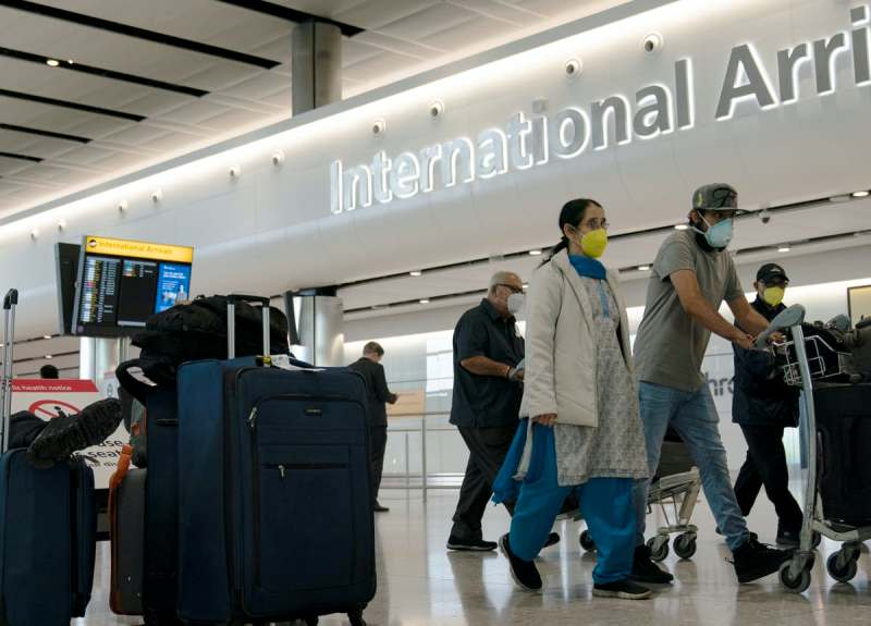 14-day mandatory quarantine on return from the UK