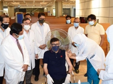 Obaidul Quader receives corona vaccine